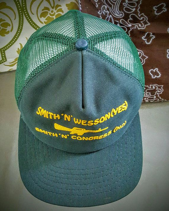 Check out this item in my Etsy shop https://www.etsy.com/listing/471111693/smith-n-wesson-snapback-hat