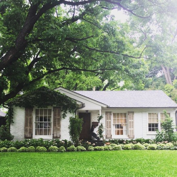 Sweet painted Brick ranch, such great curb appeal.    The Potted Boxwood