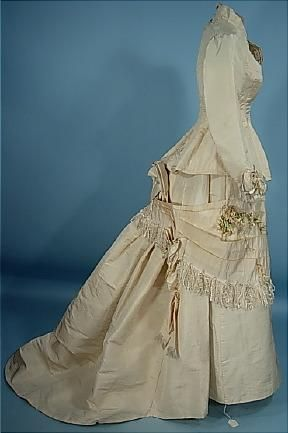 Circa 1875 Ivory Paper Silk 2-piece Fly-Tie Silk Floss Fringe Bustle Wedding Gown with Original Decorations and Corset-Laced Back.