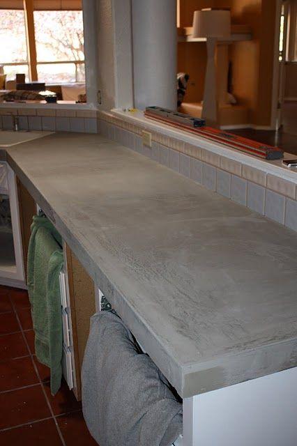 concrete counter tops poured over existing tile counter top.  http://designstocker.blogspot.com/2011/08/concrete-countertops.html