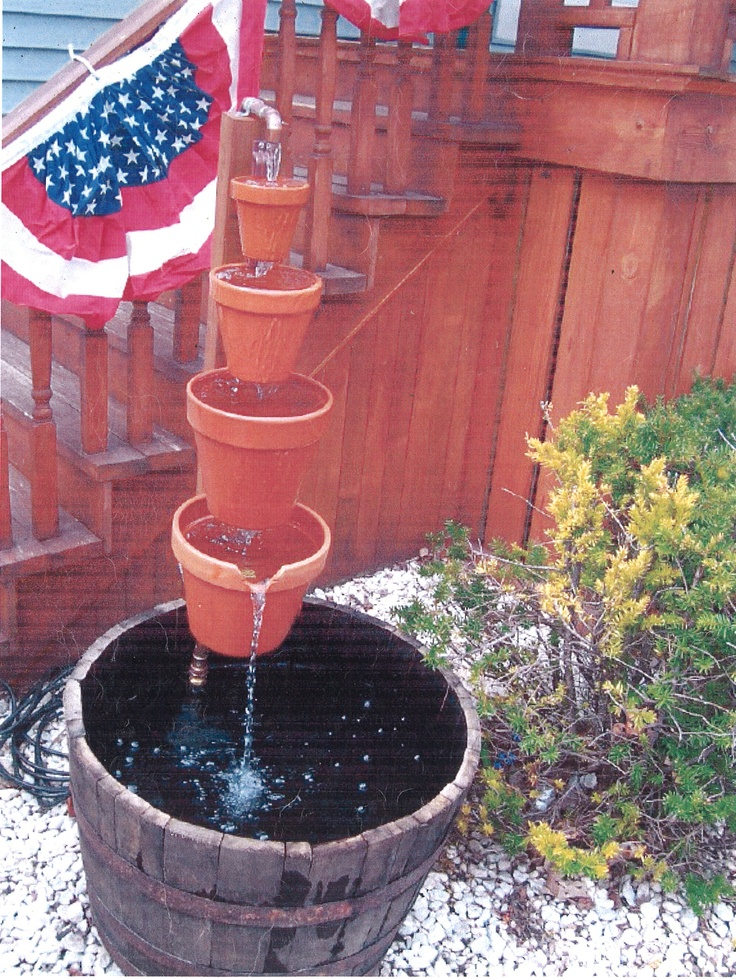DIY ...Waterfall clay pot fountain...Great project for kids, Dad, or Grandpa....one size fits all...hangapot clay pot clips... as seen in Country Living and DIY magazines.  5 for $19.95 free shipping   www.hangapot.com