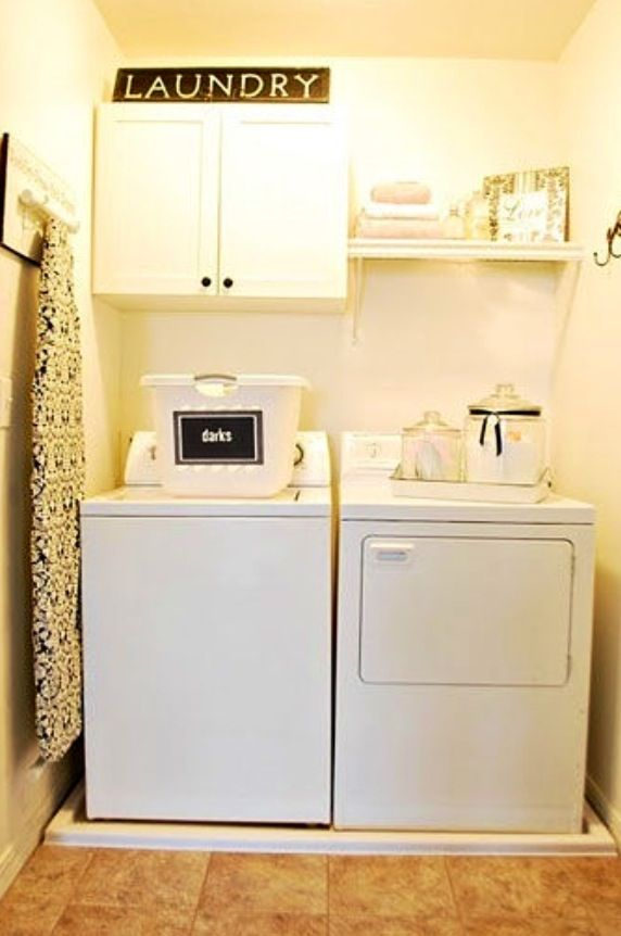 Small laundry room makeover… needs some color but I like the cabinets and shelf