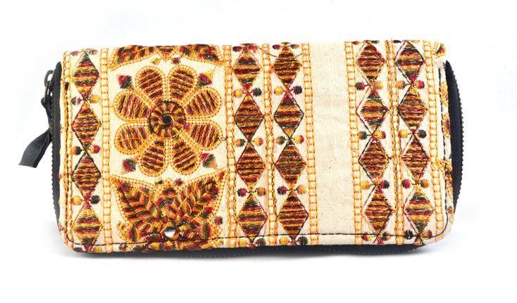 Handmade Old Style Hand Embroidery Wallet used girls and womens to carry money and cards ,mobiles etc.spacious and light weight one inside zip two partion with zip closer.  #Buyhandbagsonline #HandmadeHandbags #Authenticdesignerhandbags #Womenswallets #Pursesonline #Handmadeitems #Styleincraft