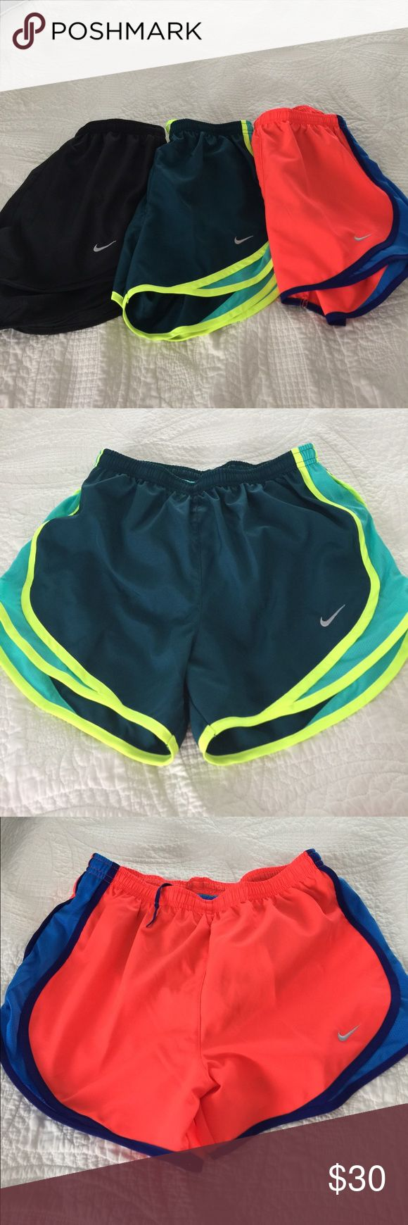 NWOT Nike Bundle Running Shorts W/ Mesh Underwear NWOT Nike Bundle Running Shorts. Bought these at the Nike Store and popped tags without trying on. Too big..Never worn Cute colors for the summer. Nike Shorts