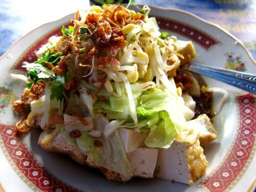Kupat Tahu. Tofu, rice cake and vegetable served with sweet peanut souce. From Magelang, Central Java.