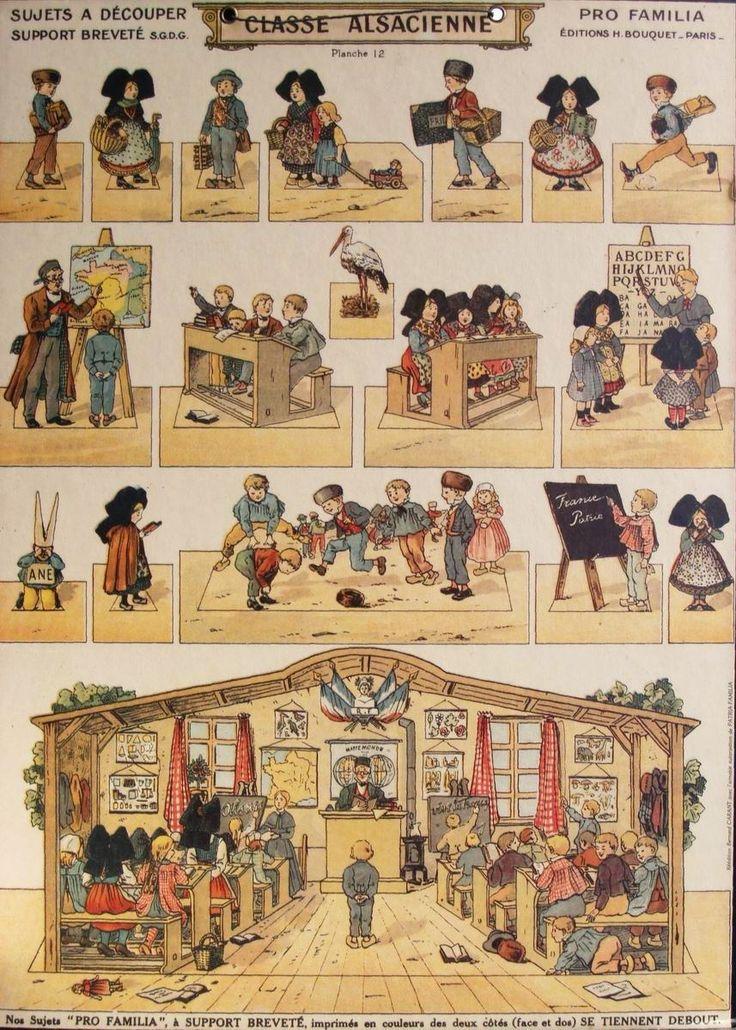 Charmante planche à découpée illustrant l'école de la république.Trouvée sur le site: www.bibert.fr/Marckolsheim_fichiers/Fahrner_fichiers/Classe_Alsacienne.jpg