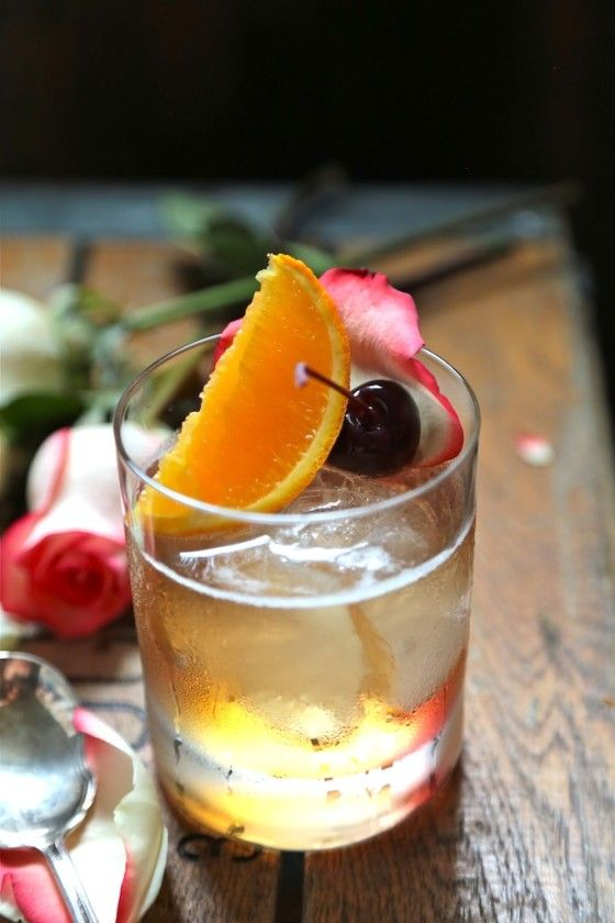 Rosewater Old Fashioned 1/2 ounce rose water simple syrup 3 ounces whiskey 3 dashes of Angostura bitters Jarred Bing Cherry or Maraschino Cherries Sliced Oranges