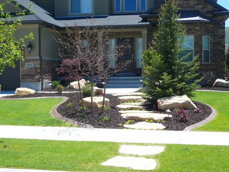 front yard landscape idea utilizing stones trees and shrubs - Front Yard Landscape Design Ideas