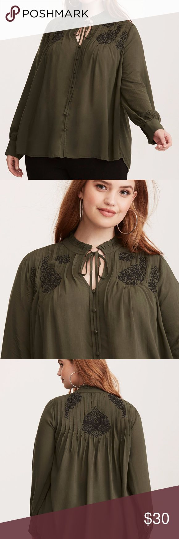 Torrid Embroidered Challis Tie Front Blouse Olive Torrid embroidered challis tie front blouse in olive, size 1 (1X - 14/16)-but this is generously sized.  As seen on a 2X dress form.  Worn once, hand washed in cold & hung to dry.  This blouse is simply too good to pass up. The rich olive green challis has a silky feel and a swingy fit helped along by a peasant silhouette and sleeves. The button front lends a polished touch, along with a tie neck. The black floral embroidery is the definition…