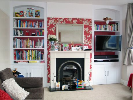 wall mounted tv above built in cupboard. Nx