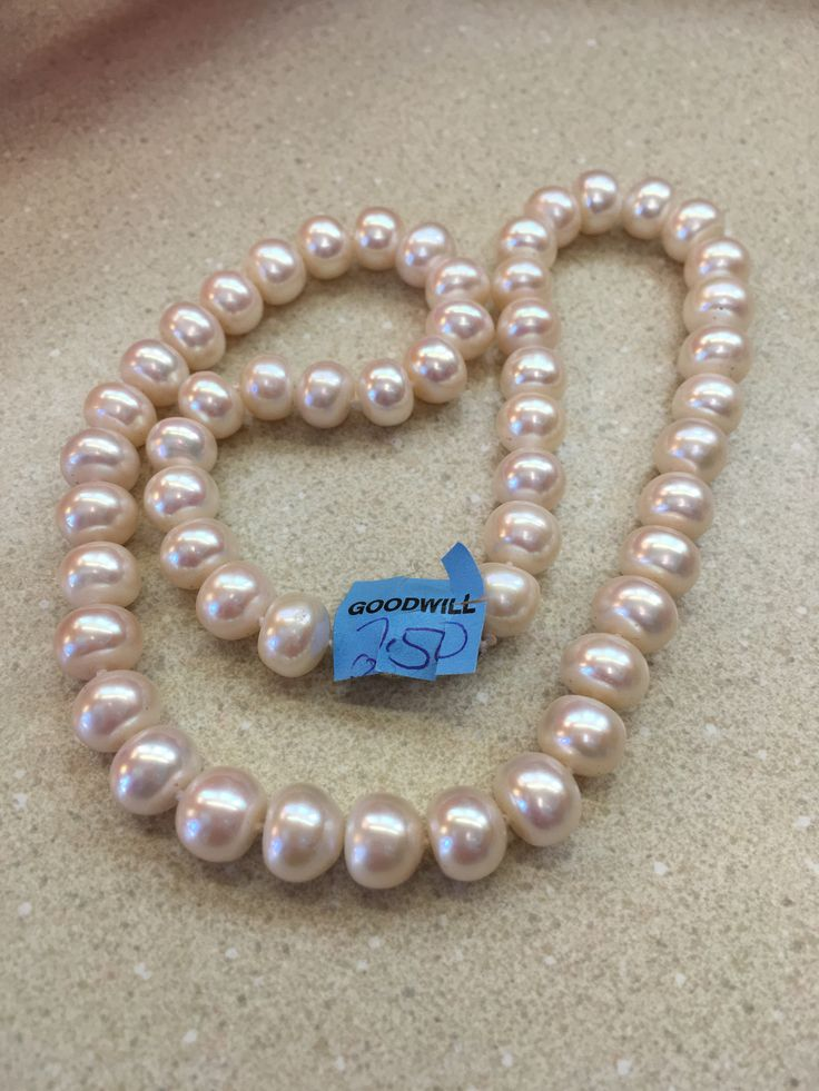 $2.50 genuine pearls, Goodwill Industries.
