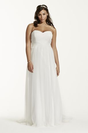 Magnificent is an understatement for this ruched tulle wedding dress. Long and soft, this delicate gown is simply gorgeous.   Strapless bodice and elegant empire waist will cinch at the waist, then fall softly.   Criss-cross ruching on bodice provides a slimming focal point.  Sweep train. Sizes 16W-26W. Available in store and online in Soft White. Available for special order only in store and online.  Fully lined. Back zip. Imported polyester. Dry clean only.  Missy: Style …
