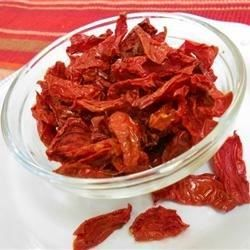Worth their weight in gold. Four pounds of  tomatoes and a bit of salt produce a quart of these amazing dried tomatoes. We like to store them in olive oil to keep them plump and moist.