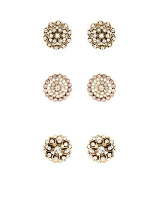 Crafted from gold-tone metal, our Eliza three-pair flower stud earrings are embellished with sparkling crystal gems. Please be aware that this item is non-re...