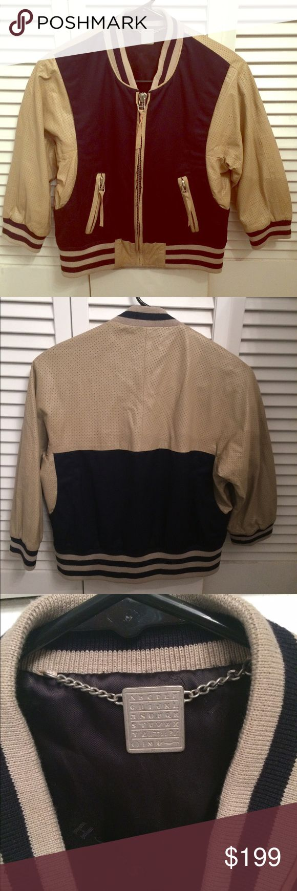 Shipley & Halmos perforated leather tan jacket Excellent condition.  Very cute 3/4 sleeves tan leather jacket And dark blue fabric combination.  Inside lining is in great condition as well.  Very cute and trendy!  Final sale Shipley & Halmos Jackets & Coats Jean Jackets