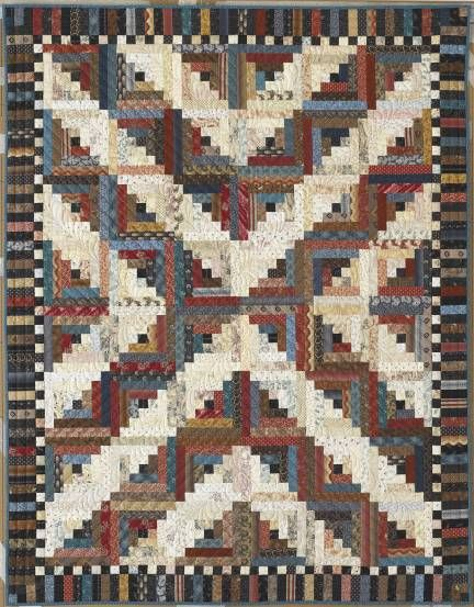 """Traditional Log Cabin quilt - Judy Martin's Log Cabin Quilt Book, 2007. Traditional design with border designed by Judy Martin. Pieced by Judy Martin. Quilted by Sherry Rogers-Harrison. 50"""" x 64"""". Alternate sizes of 92"""" x 92"""" and 64"""" x 92"""" also presented."""