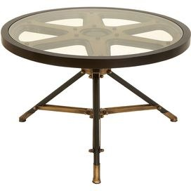 Accent table with a tripod silhouette and film reel top.   Product: Accent tableConstruction Material: Metal and glassColor: Bronze and goldDimensions: 20 H x 32 DiameterCleaning and Care: Not recommended for outdoor use. Wipe with dry cloth.