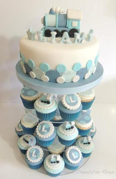 Baby boy train themed christening cake and cupcakes
