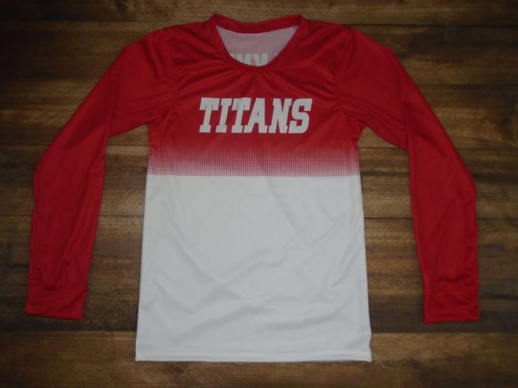 Have a look at this custom shooting shirt designed by Dickson Trinity High School Titans Basketball and created at UNIVERSAL ATHLETIC in Bozeman, MT! Create your own custom uniforms at www.garbathletics.com!