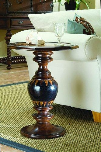 This transitional-styled pedestal accent table has a hexagonal top and heavy base, both with tortoise shell accents. Resin; Sea Shell; Stone.