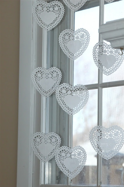 heart doily window decor, so simple and pretty. Another good idea for the windows at our shop.