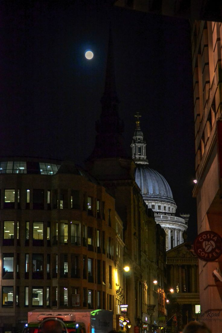 I simply loved roaming the streets of London after dark. Particularly since it was pitch dark by 6 pm. And during the days I was in the city there was a spectacular full moon. Every view of the city was so much more beautiful with that moon, including the St. Paul's Cathedral here in the photo.