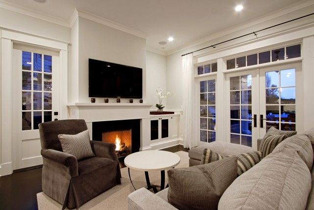 Suzie: Paul Moon Design - Chic living room design with French doors, transom windows, gray ...