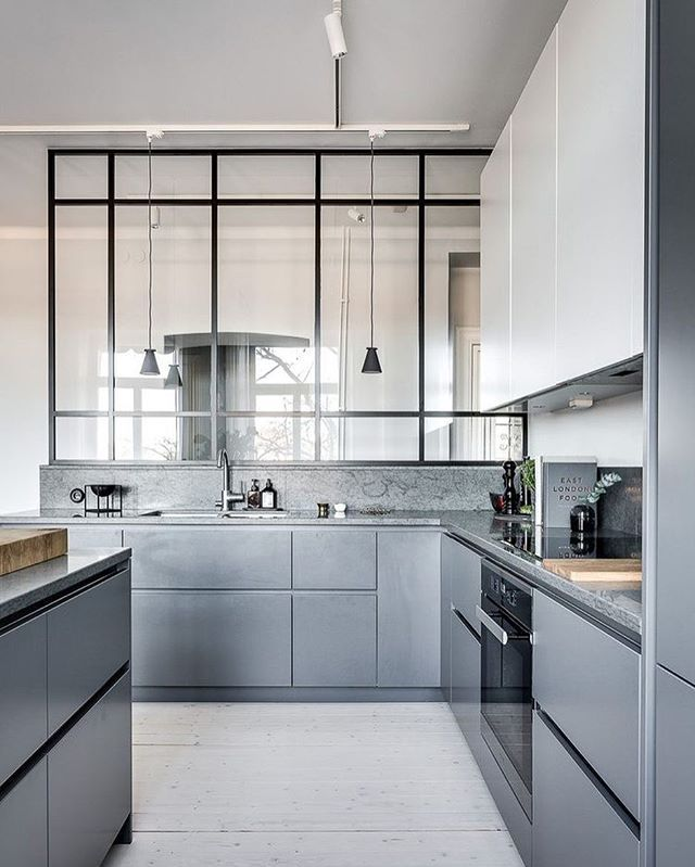 Open bright kitchen with an abundance of counter space #interiors #kitchen