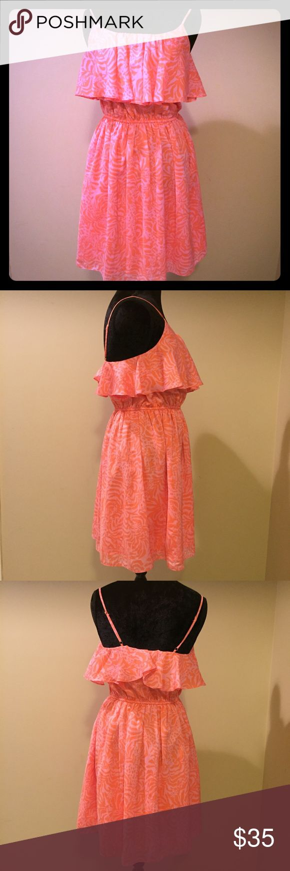 Lilly Pulitzer Dress Lilly Pulitzer for Target dress for sale! Cute pink giraffe print and fabulous soft material. The straps are fully adjustable and the waist has some elastic to fit a wide range of sizes. Even though I usually wear a L/XL I can still fit this! NWOT. I have never worn this! Lilly Pulitzer Dresses