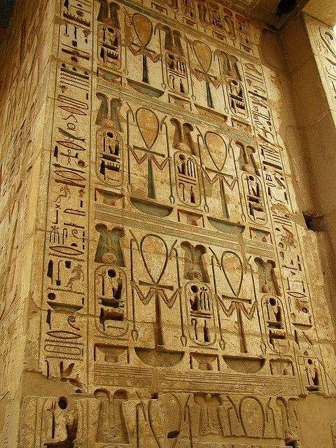 Egyptian hieroglyphics at Medinet Habu. Medinet Habu is the name commonly given to the Mortuary Temple of Ramesses III.