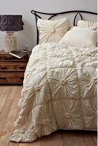 We want to go with all ivory bedding. I love this. Pretty sure J would not.