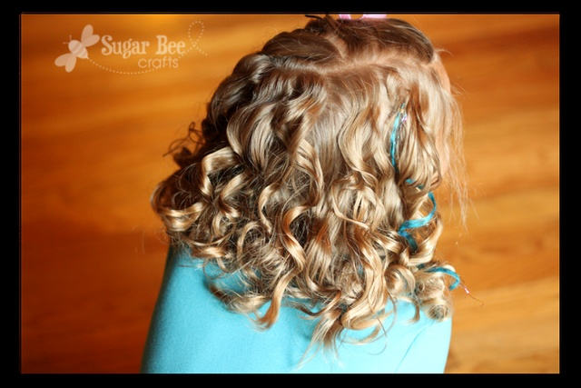 Rag Rolled curly hair. roll wet hair in fabric, leave overnight, unroll in morning