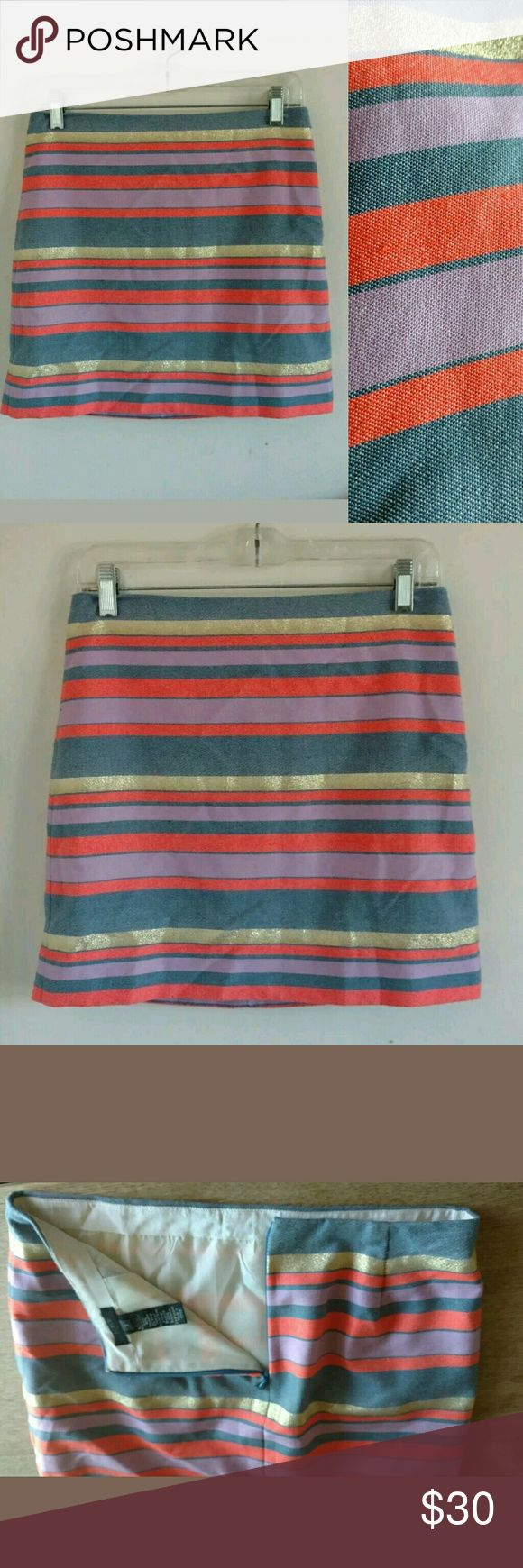 """J. Crew Factory Metallic Striped mini skirt Sz 2 J Crew multi color Striped Mini Skirt. Features summery multi-color stripes. The color combination is Coral, lavender, Denim Blue, and a Gold metallic thread. Sz 2 (actual measurements are as follows)? Waist 28""""? Length 15.5""""? Hips 35""""? Condition: excellent! No stains. J.Crew Factory Skirts Mini"""