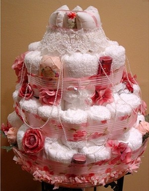 """Rolled hand towels! Bridal Shower """"Towel Cake""""--  buy hand towels roll them up and get ribbons and garders and pull all the towels together to make a cake shape. Use as decoration, and hostess disembles when everyone leaves, and the bride takes the towels home with her."""