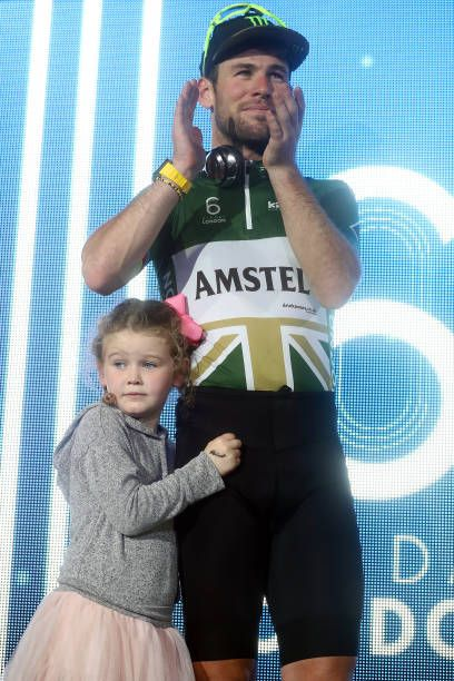 Mark Cavendish of Great Britain stands on the podium with his daughter Delilah Grace after finishing second in the London Six Day Race at the Lee...
