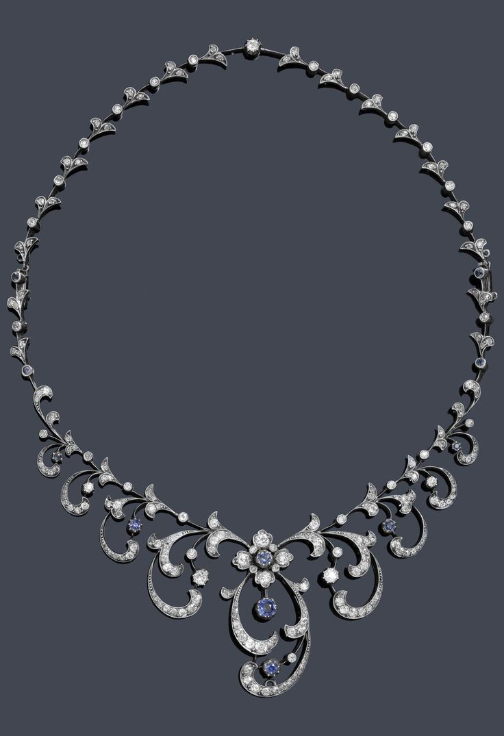A VICTORIAN DIAMOND AND SAPPHIRE NECKLACE, CIRCA 1890. Necklace with graduated tendril, floral and foliate motifs, set throughout with old European-cut diamonds, rose-cut diamonds and sapphires, mounted in silver topped yellow gold. The rear of the necklace is removable and can be divided into 4 segments. 47 cm long. With original case inscribed Harvey & Gore, 1 Vigo Street, London.
