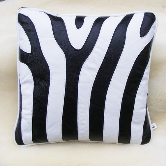 """Made of beautiful cowhide in black and white life size zebra stripes    *it is just the opposite stripes of black zebra    *16"""" white and black design with white welt    *black faux fur back with zippered closure. $90"""