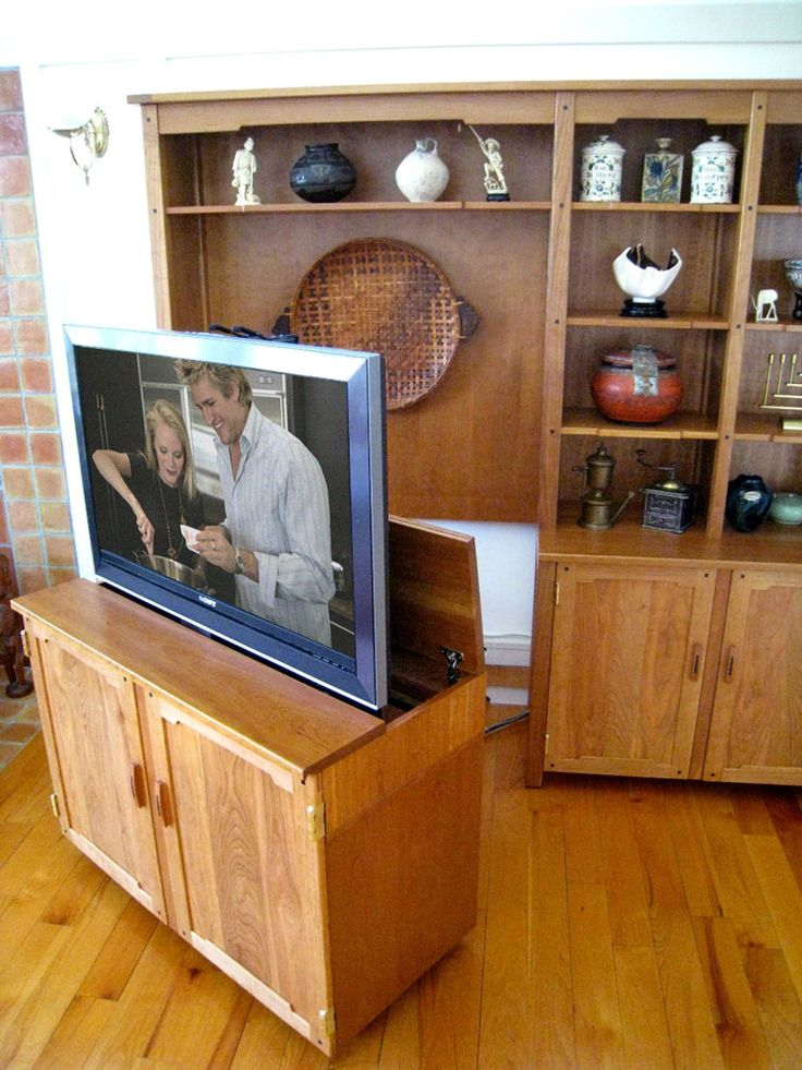 our custom pull out tv stand was built to allow the television to pop up inside of a pull out tv cabinet