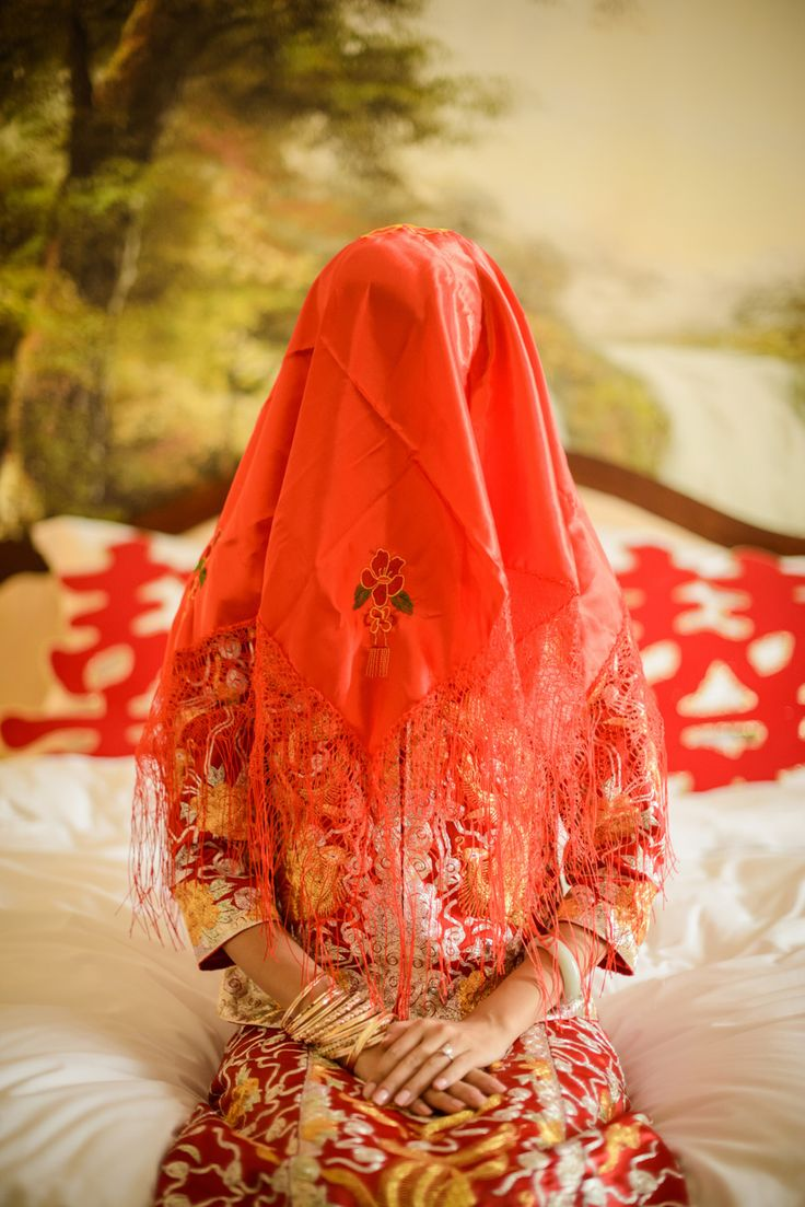 Bride wears a red veil as part of Chinese tradition. Lu and Kat's Stylish Wedding in Qingdao, China