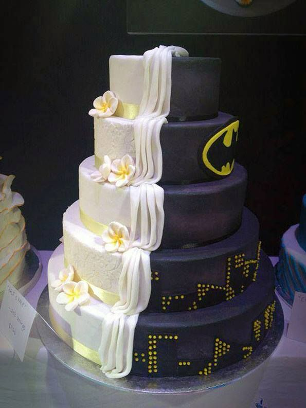 Because marriage is all about compromise, here's a wedding cake that's half Batman-themed, half traditional.