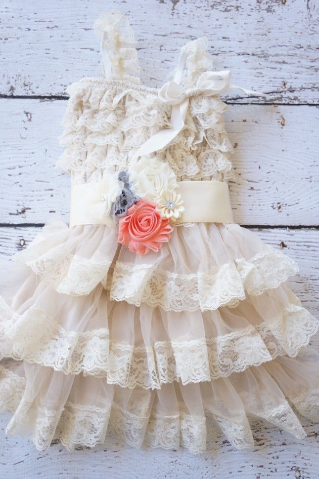 A Dozen Creative Dresses for Your Flower Girl via Brit + Co. so cute country flower girl dress with cowboy boots!!