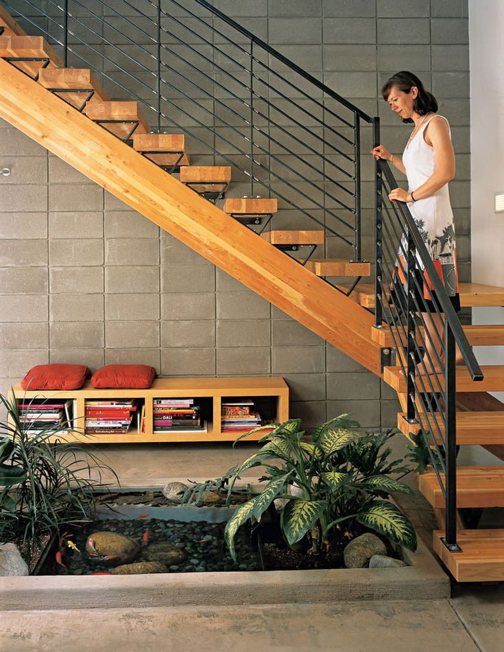 i like this arrangement, with plants, water, and rocks under floating stairs.
