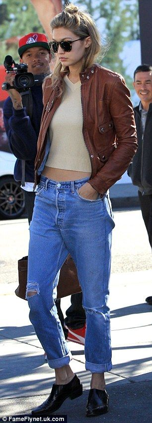 Lovely in leather: Gigi also wore a tan jacket and black and burgundy brogues, while carry...