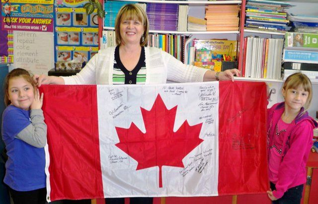 Harbour Grace Primary Students Celebrate 'Special' National Flag Day (Newfoundland) with a flag signed from Afghanistan.