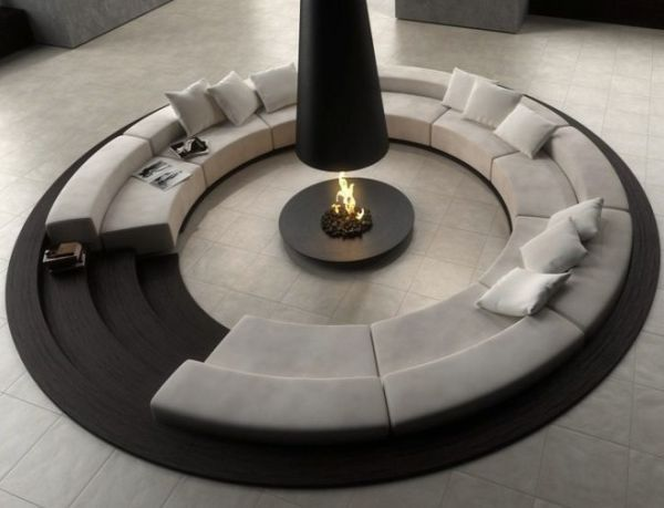 Sofa curled around a fire