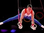 Kristian Thomas of Great Britain competes in the rings