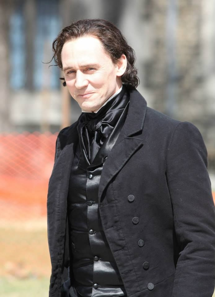 Tom Hiddleston seen dressed in costume while filming scenes for their new horror movie 'Crimson Peak'  Sports black dyed hair and a matching black period costume on the set of his highly anticipated upcoming movie Crimson Peak on Wednesday (April 16) in Toronto, Canada. torrilla.tumblr - Just Jared