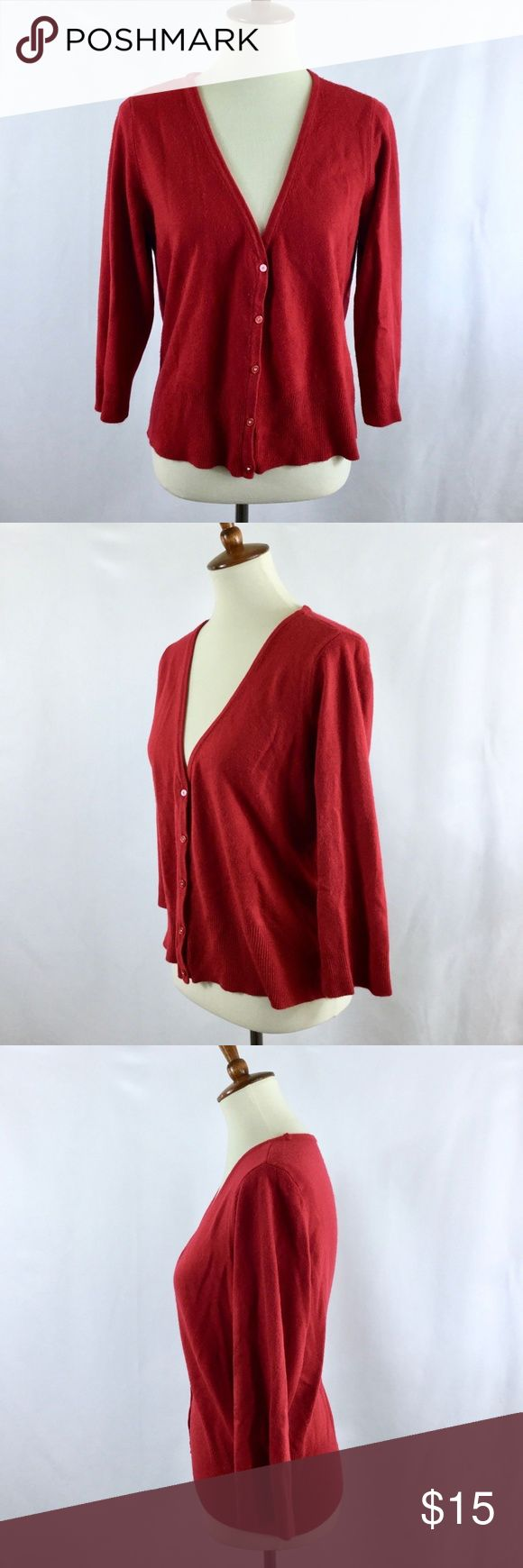 "Mossimo XXL Red Cardigan Sweater 3/4 Sleeve Bling Pretty and versatile red cardigan sweater. The buttons have little rhinestones on them. Button front closure, 3/4 sleeve length, v-neck. 100% Acrylic, pre-owned and in good condition.  Measurements: Bust: 44"", Length: 23"" Mossimo Supply Co. Sweaters Cardigans"