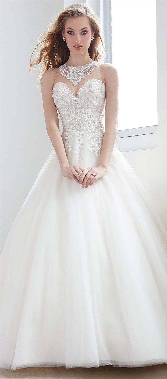 With a dramatic beaded bodice and illusion collar, this gown needs no other accessories.