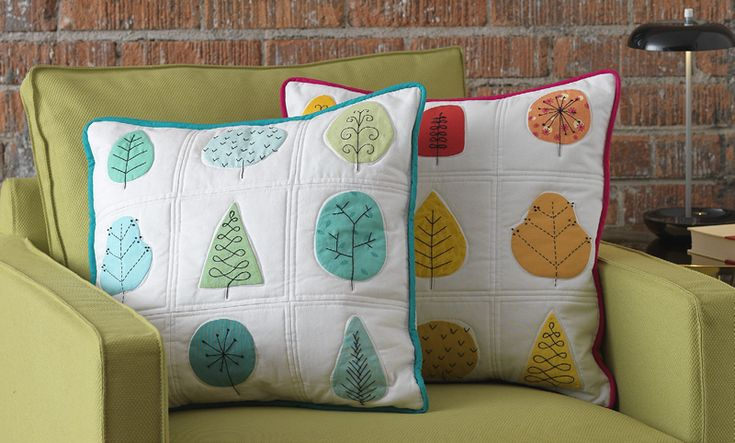http://www.sewmamasew.com/2014/02/all-seasons-pillow-pdf-pattern-from-the-quilters-applique-workshop/